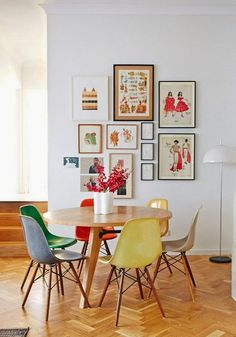 Mismatched coloured chairs are such a lovely idea for a modern dining room
