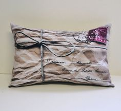 """Mail Parcel pillow by lisawinestudios on Etsy, $19.99 Ships from Canada. This French mail parcel style pillow is a fun piece for any home!  Image is printed on soft polyester & pillow is filled w/ polyester fiber fill. The back is made of linen. Pillow measures 8"""" x 12""""."""