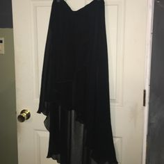 Black chiffon high-low skirt with layers flowy black chiffon skirt with a high low design. Stretchy waistband and layers. Love Culture Skirts High Low