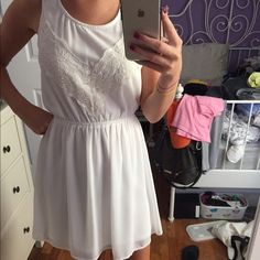 Size small white summer dress! Worn once on July 4th. Looks brand new. Size small. Has a small cut-out in the back. Dresses