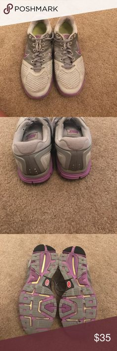 Nike lunarglide 2 Nike lunarglide 2. Some wear/ coloring on shoes. Overall good condition.  Only worn with  socks. Nike Shoes Sneakers