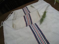 antique grain sack -- would love to use for kitchen chairs!