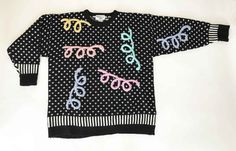 """Get loopy with this amazing jumper in black with graphic border hems and fleur de lis all over pattern and giant loops in 3D embroidery in lovely pastels. SECTION: OPTIC POP x SPORTY MAKER: REFERENCE POINT MATERIAL 100% Acrylic SIZE; L/ Fits O/S  CONDITION: Excellent Vintage Condition No stains, tears, repairs, rips, or holes  ✂ - - - MEASUREMENTS: Inches (OBJECT is flat: DBL chest x hem) Chest Width: 23"""" Hem Width: 21"""" Shoulder-to-Shoulder: 22"""" HPS (high point shldr to hem): 26 1&#..."""
