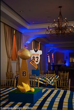 Bar mitzvah bat mitzvah decor design football theme centerpiece heisman trophy centerpiece homecoming decor junglespirit Choice Image
