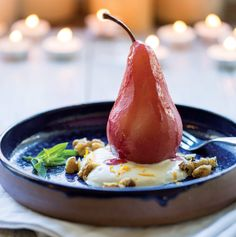 A hot bath of spiced red wine gently cooks seasonal pears into a tender, glimmering fruit dessert fit for any crowd.