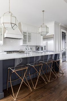 Gabby Angela Counter Stools sit at a white marble countertop accenting a charcoal gray island finished with a stainless steel sink and a polished nickel deck mount faucet lit by two Suzanne Kasler Morris Lanterns. Cheap Granite Countertops, Kitchen Cabinets And Countertops, Kitchen Counter Stools, Granite Kitchen, Kitchen Islands, White Cabinets, Modern Kitchen Interiors, Modern Farmhouse Kitchens, Interior Design Kitchen