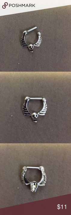 14g Septum Clicker 14 gauge septum clicker, surgical steel. Skull with wings. If you're a 16 gauge and nervous or hesitant to put in a 14 gauge, I switch between the two sizes all the time and it doesn't hurt at all nor will it be stretched out or anything like that. Let me know if you have any questions! 😊 BodyArts Accessories