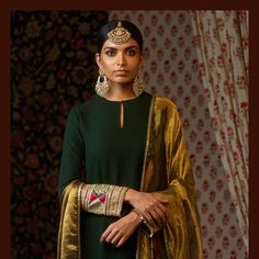 Embroidered forest green matka kurta and sharara with a gold tissue odhana. Paired with the classic Sabyasachi sangeet jewelry. Made in 22k gold with uncut diamonds, emeralds, rubies and Japanese cultured pearls.  For all jewellery related queries, kindly contact sabyasachijewelry@sabyasachi.com  #Sabyasachi #SabyasachiJewelry #TheWorldOfSabyasachi