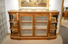 An Exhibition quality Victorian Period sycamore, purple heart and kingwood ormolu mounted credenza.