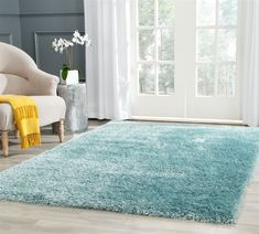 Rug from Charlotte Shag collection. From Safavieh's Charlotte Collection, is a light blue shag rug constructed of durable synthetic fibers to bring lasting beauty to mod home decor. Light Blue Area Rug, Blue Area Rugs, Brown Shag Rug, Shaggy Rug, Solid Rugs, Soothing Colors, Bedroom Carpet, Condo Bedroom, Teen Bedroom