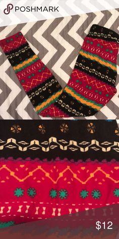 LuLaRoe Os leggings Great tribal print! Only worn two times. Contains black, yellow, teal, and fuchsia. LuLaRoe Pants Leggings