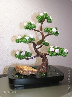 : Flowering Bonsai Beads, Gypsum, Clay, Wire.       The instructions are for the stand, but I think that almost anyone that has worked with beads should be able to figure out this beautiful Bonsai.