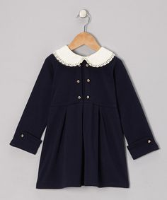 For the ultimate mix of classic and sweet, dress little lovelies in this fetching frock. Decorated with bitty button accents and a lacy Peter Pan collar, it radiates girly charm. Plus, the back zipper closure makes it a cinch to pop on! 95% cotton / 5% spandexMachine wash; tumble dryImported