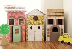 Adorable Kid Play Houses on A Beautiful Mess , crafts, kids, children, kid crafts, play, play time, pretend, house, cardboard, cardboard crafts, cardboard houses, diy, diy cardboard house