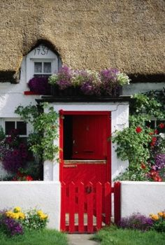 Irish Cottage Welcome .Ireland, County Waterford, General, Thatched Cottage with red door and gate © Travel Library Limited / SuperStock Irish Cottage, Cozy Cottage, Cottage Style, Cottage Door, Red Cottage, Portal, Cottages Anglais, Thatched Roof, Thatched House