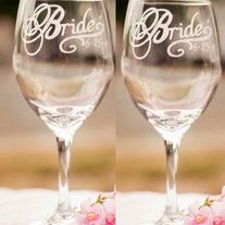 """This is the day you've been dreaming of; from the historic day that love won to the day when she (or you) got down on one knee. Celebrate in style with these beautiful, hand-engraved Bride glasses. Featured in Real Weddings Magazine, these personalized glasses read """"Bride"""" and your wedding date u..."""