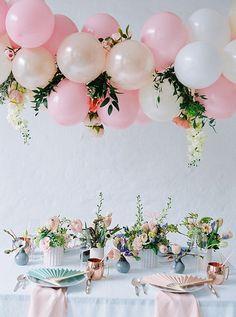 Suspended balloon wedding centerpiece for reception table