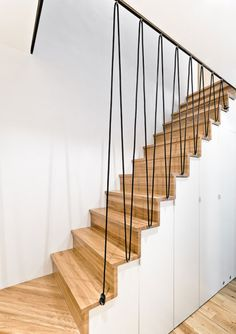 plain white wall paint color background with wooden treads also black banister design