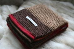 handknitted scarf in a midcentury colour mix by jonesyinc on Etsy, £40.00