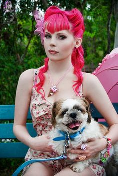 bright pink hair, victory rolls, awesome fringe + a dog!!!
