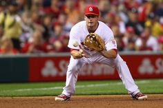 ST. LOUIS, MO - JUNE 12: David Freese #23 of the St. Louis Cardinals fields a one hopper against the Chicago White Sox at Busch Stadium on June 12, 2012 in St. Louis, Missouri. (Photo by Dilip Vishwanat/Getty Images)