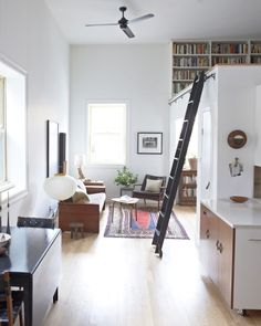 Simple idea for a moveable ladder that would get you to the loft bed and the casement windows.