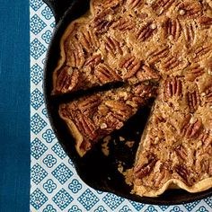 Utterly Deadly Southern Pecan Pie | Once you've made a pecan pie in a cast-iron skillet, you may never go back to a pie plate. | SouthernLiving.com