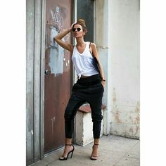 White wrap around tank, drop crotch trousers, black strappy heels. Perfect casual outfit.