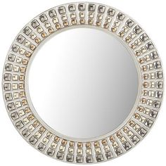 The Ennis Mirror is a highly adaptable species. Its silver frame features recessed channels with indentations that are tinted bronze, silver and gold.