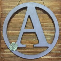 This rustic distressed initial letter A is surrounded by a rustic Lavender 14 diameter circle. Has jute twine hanging capabilities. This rustic door hanger has a removable accent flower so that you can arrange it to your liking.  Message me if you have a special letter in mind or a request and I ca