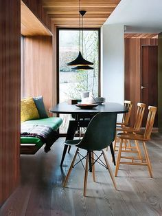 This dining space is modern yet has nods to the 60's. It's urban yet has a cabin kind of feel. Looks great. The flooring is something very similar to our Lost Cove http://www.reclaimedflooringco.com/products/lost-cove-natural-oak-floor/