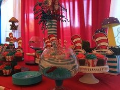Cat in the hat cake table decoration. Cat in the hat themed cake table decoration.  http://www.dreamarkevents.com/ #Dr.Seuss #catinthehat #party #kidsparty #decoration #draping #centerpiece #partydecoration #ballooncolumns #balloonarch #balloondecoration #Themedparty #parkpavilion #parkdecoration #Kidsentertainment #thingone #thingtwo #drsuess #partydecoration #partyplaner #fortlauderdale #miami #bocaraton #palmbeach