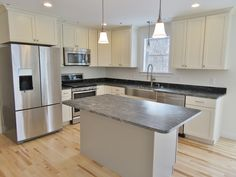 Bright #kitchen with #stainless #appliances in this new home.