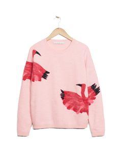 Jersey de lana merino en rosa pastel con estampado de ibis de & Other Stories, 95 €.