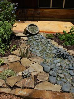 recycled glass and river stone dry creek bed