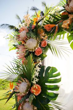 Outdoor Wedding Ceremonies Local Hawaii flowers adorn this outdoor ceremony space - Tropical Wedding Decor, Tropical Bridal Showers, Floral Wedding, Hawaiian Wedding Flowers, Tropical Weddings, Wedding Themes, Wedding Decorations, Wedding Ideas, Wedding Planning