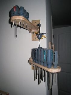 Swiveling Screwdriver Holders by woodify -- Homemade wall-mounted swiveling screwdriver holders constructed from surplus maple hardwood flooring, nuts, and bolts. http://www.homemadetools.net/homemade-swiveling-screwdriver-holders