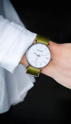 Parsonni Watches. The interchangeable band colors make this a very versatile watch!