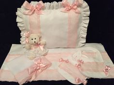 All white and pink  Pram set with Swarovski crystals. Matching bibs and Swarovski teddy