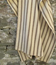 These examples were woven in two strips on a narrow loom and then hand stitched together down the centre  Usually heavier in weight and often woven in soft, earthen colours, characteristic of authentic vegetable dyes, the blankets pre date 1910 and the introduction of the wide loom  This blanket woven with twill weave with cream and chocolate brown stripes  £285