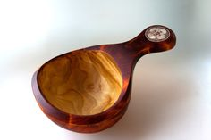 Guksi. A cup made of birch wood with intarsia of reindeer antler.