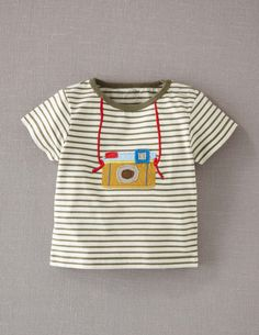 camera tee...AM embroidery idea?  Could also do with felt if we got really crafty ;)
