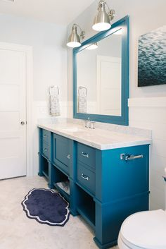 Blue bathroom cabinet and mirror