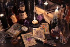 Still life with the tarot cards, knife, books and candles on witch table