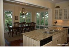 Open kitchen and dining room floor plan; perfect for keeping an eye on the kids  #KiawahIslandSCRealEstate #CharlestonSCRealEstate Click here to see more of this great home!