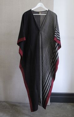 """Gorgeous boatneck caftan with metallic circle Color: Black with gold circle - — Length 49"""" - — One size best for 4 to 12 - — Free domestic shipping"""