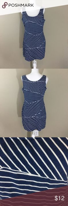 Striped blue mini dress Used but good condition. It has fading throughout but still looks good with some wedges! Mini skirt for sure! It also has a built in support top. Lines give slimming effect. Daisy Fuentes Dresses Mini