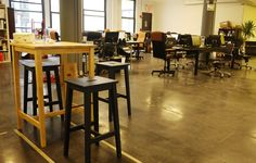 Concrete floors - I would want to put Rugs under the desks probably...   Coworking Space - Ensemble, New York, USA