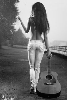 The 2 things I like the most HOT girls and COOL Guitars. But she needs to not drag that guitar!!