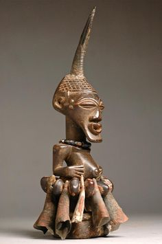 Africa | Nkisi figure from the Songye people of DR Congo | Wood, horns, beads, rope, seeds, metal, animal skin | Early to mid 20th century